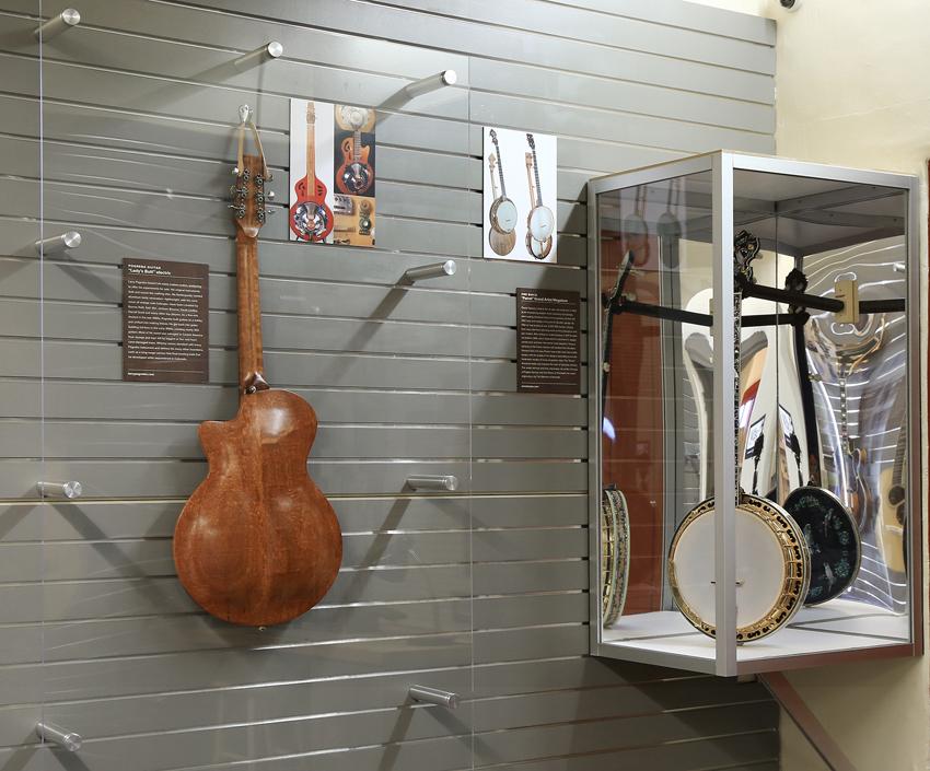 pogreba guitar and banjo up in display case