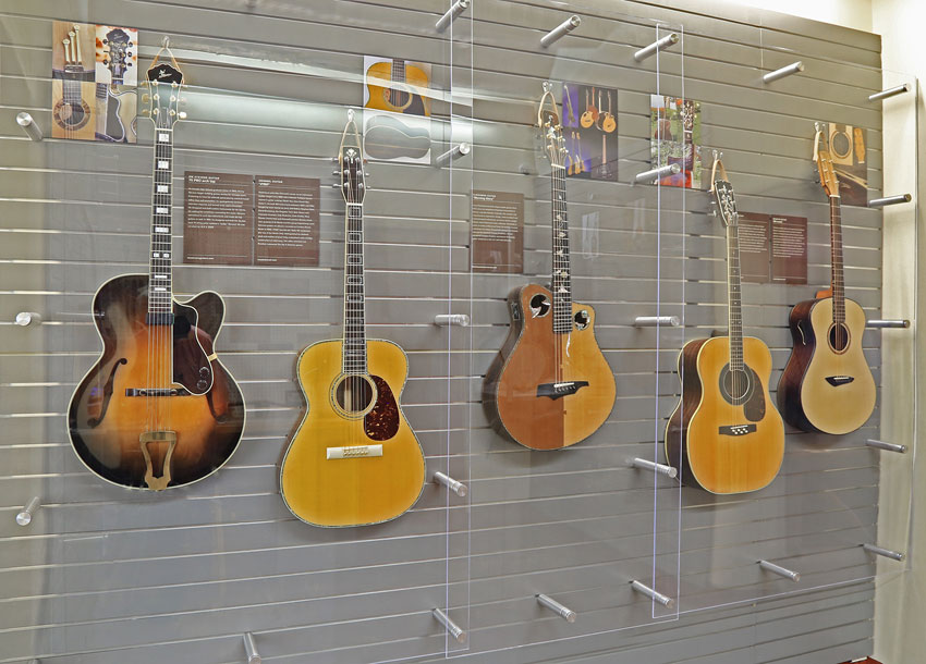 various acoustic guitars up in display at cmhof museum