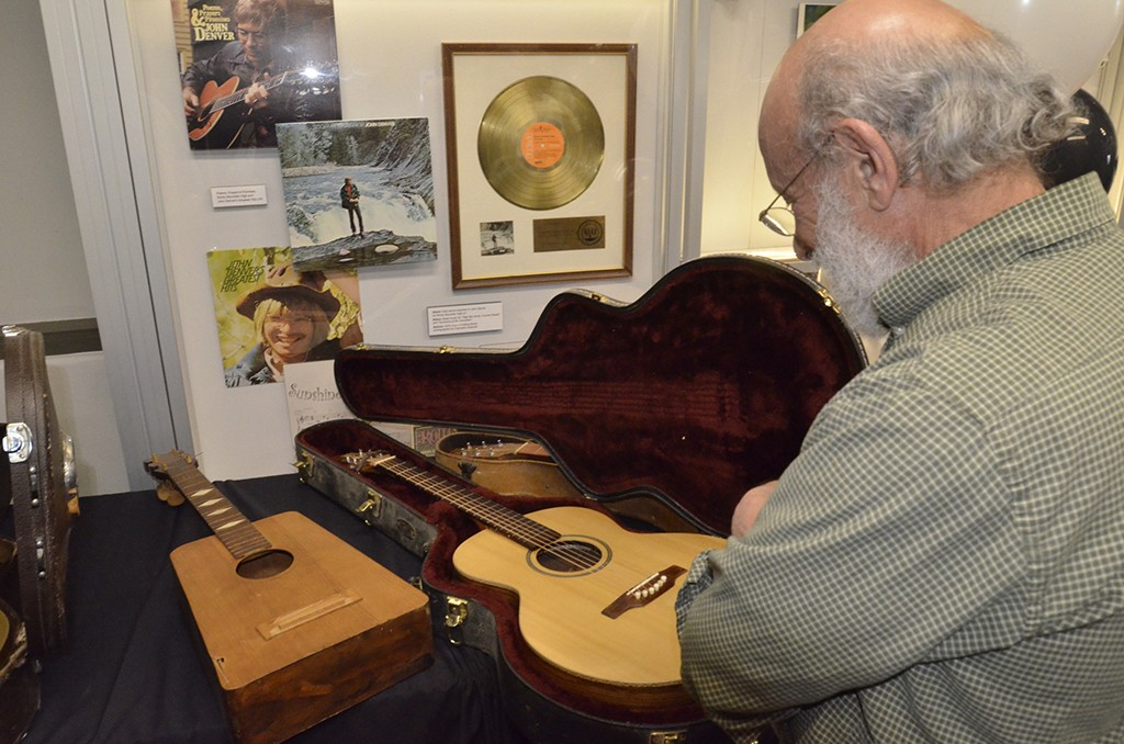 "Admiring luthier Max Krimmel's first stringed instrument, built circa 1965 at a Denver Folklore Center course in guitar making (""Build Your Own Peach Box Guitar"")"