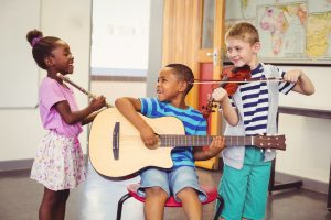 group of students learning to play music