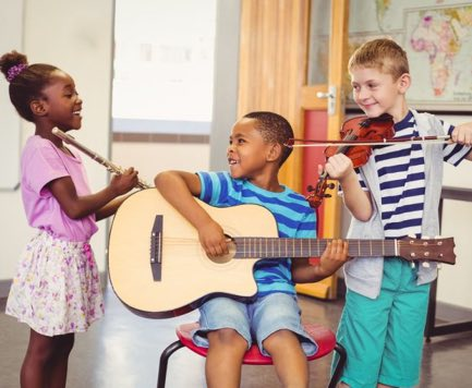 students-learning-to-play-music
